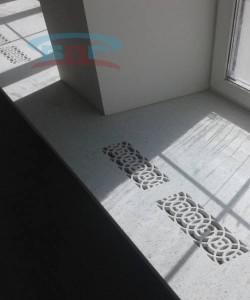 Воздуховоды-отверстия в виде рисунка в каменной столешницы для прохода горячего воздуха от радиаторов отопления ( батареи )